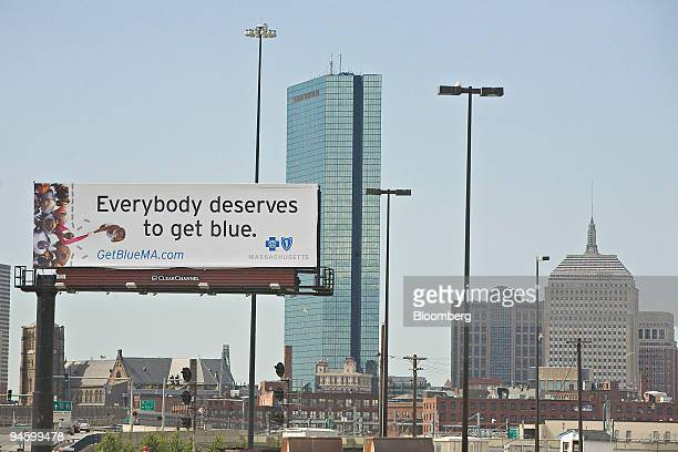 The Boston skyline stands beyond a billboard advertising the Massachusetts statesubsidized health plan Friday June 29 2007