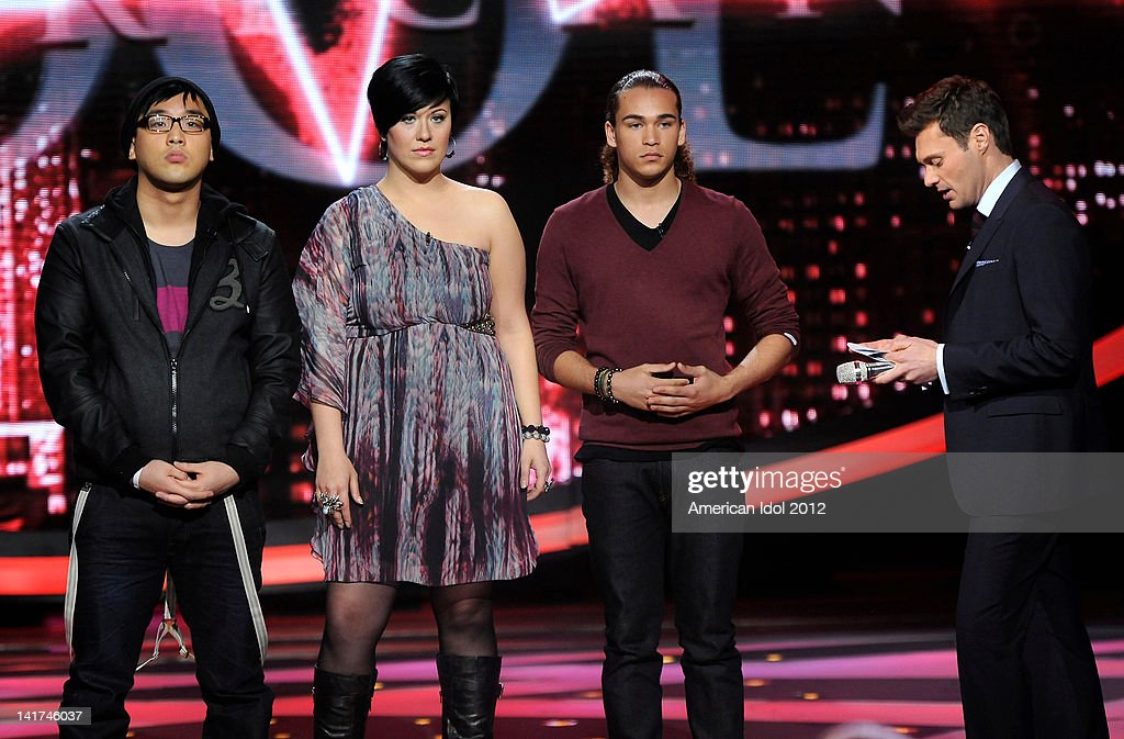 The bottom 3 contestants Heejun Han, Erika Van Pelt and DeAndre Brackensick and host <a gi-track='captionPersonalityLinkClicked' href=/galleries/search?phrase=Ryan+Seacrest&family=editorial&specificpeople=201694 ng-click='$event.stopPropagation()'>Ryan Seacrest</a> onstage at FOX's 'American Idol' Season 11 Top 10 To 9 Live Elimination Show on March 22, 2012 in Hollywood, California.