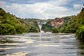 The bottom of the Murchison Falls waterfall reached by a safari boat tour in the national park. Too bad this place, lake Albert, is endangered by oil drilling companies