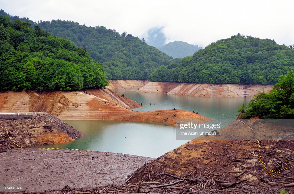 The bottom of Yagisawa Dam appears on July 24, 2013 in Minakami, Gunma, Japan. Short rainy season results in serious water shortage at dams which provide water to Tokyo and its surburbs, six prefectures are under water restriction.