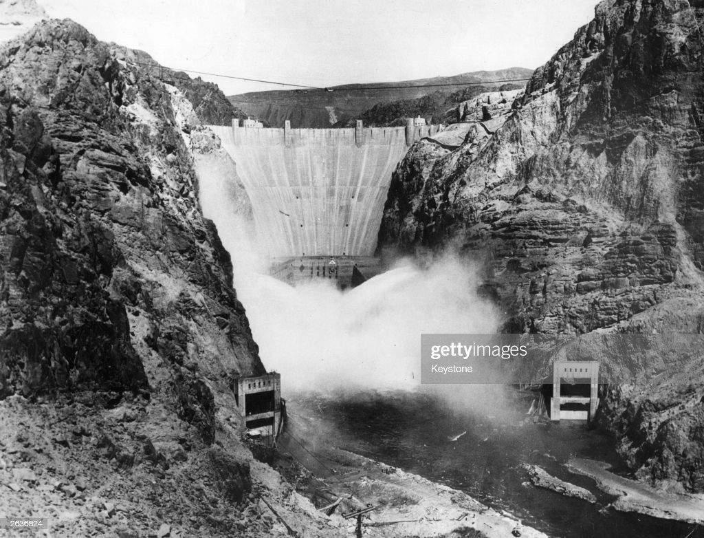 The Boulder Dam on the Arizona - Nevada border (first named Hoover Dam in 1931 when work commenced and again renamed the Hoover Dam in 1947). It harnessed water from the Colorado River for use in power generation.