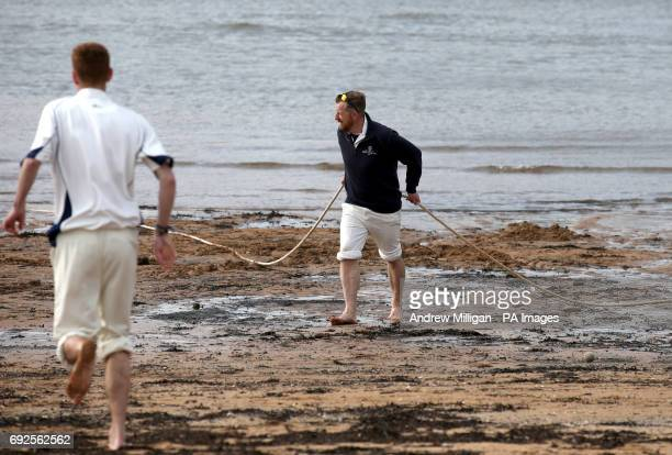 The boundary is moved as the tide comes in during the beach cricket match in Elie between the Ship Inn cricket team in Elie Fife and Eccentric...
