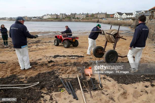 The boundary rope is put away as the tide comes in after the beach cricket match in Elie between the Ship Inn cricket team in Elie Fife and Eccentric...