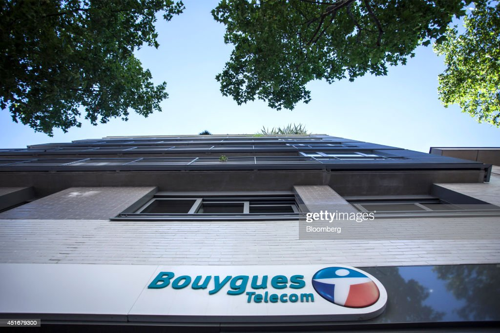 The Bouygues Telecom company logo hangs on the outside of a store operated by Bouygues SA in Paris, France, on Thursday, July 3, 2014. Bouygues Telecom, France's third-largest mobile operator, was looking for a buyer as profitability and cash generation declined. Photographer: Balint Porneczi/Bloomberg via Getty Images