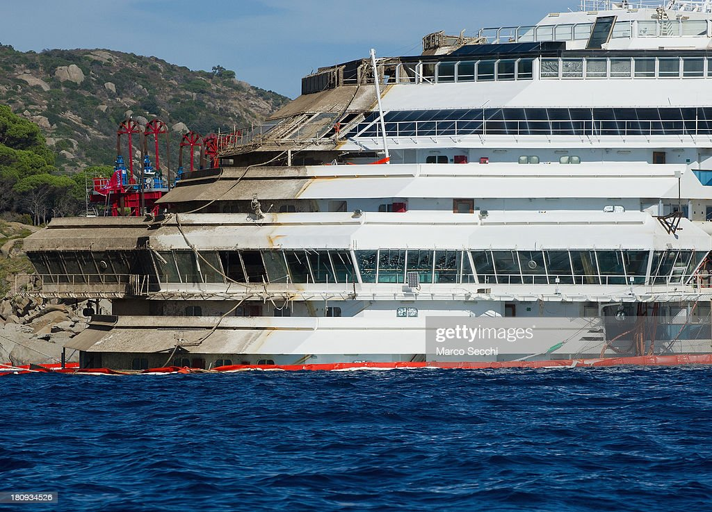 The bow (front) of the Costa Concordia cruise ship, of which several floors remain underwater, is seen in upright position on September 18, 2013 in Isola del Giglio, Italy. The vessel, which sank on January 12, 2012, was successfully righted during a painstaking operation yesterday morning. The ship will eventually be towed away and scrapped. It was the first time the procedure, known as parbuckling, had been carried out on a vessel as large as Costa Concordia.