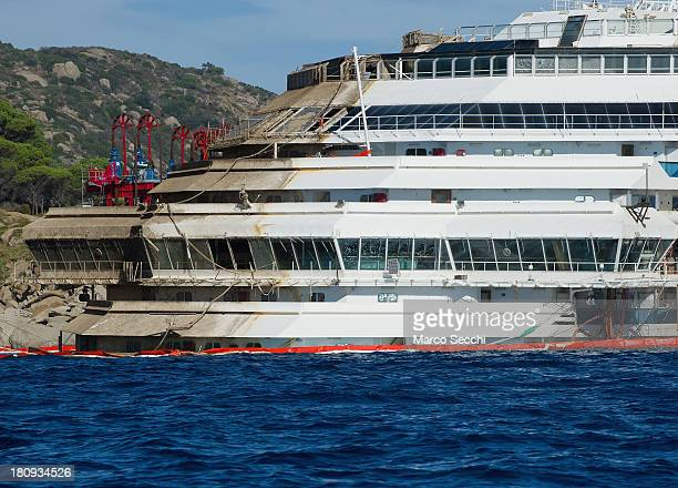The bow of the Costa Concordia cruise ship of which several floors remain underwater is seen in upright position on September 18 2013 in Isola del...