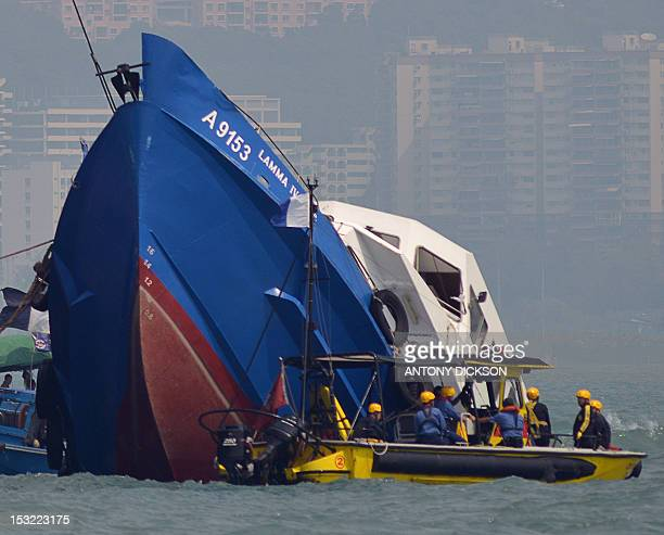 The bow of the Lamma IV boat is seen partially submerged during rescue operations on October 2 2012 the morning after it collided with a Hong Kong...