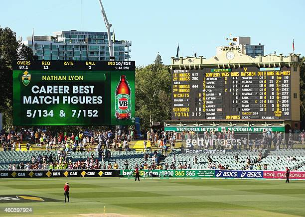 The bowling figures for Nathan Lyon of Australia are displayed on the scoreboard after Australia defeated India during day five of the First Test...