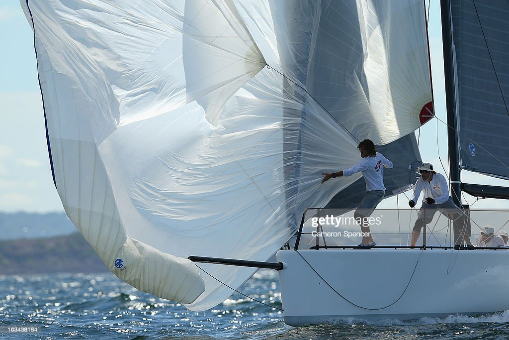 The bowman onboard 'Ginger' pulls in the spinnaker during the Sydney Regatta on Sydney Harbour, on March 10, 2013 in Sydney, Australia.