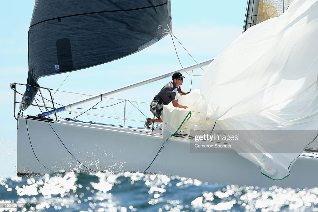 The bowman onboard 'Whisper' pulls in the spinnaker during the Sydney Regatta on Sydney Harbour, on March 10, 2013 in Sydney, Australia.