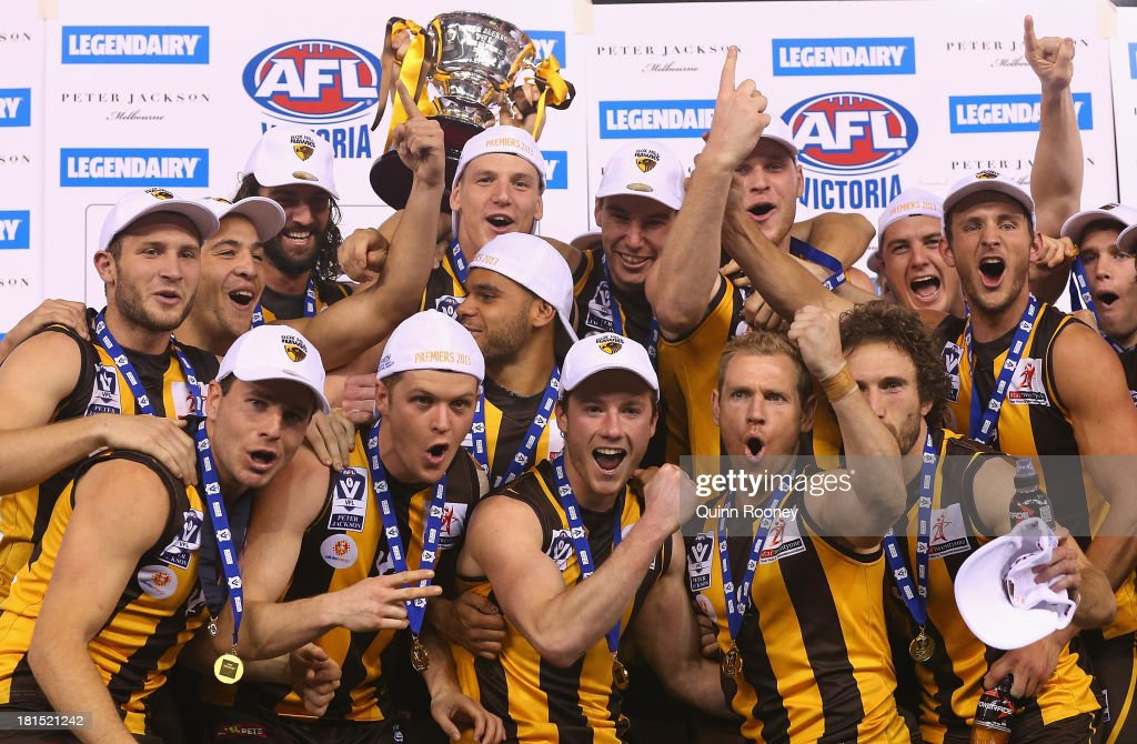 The Box Hill Hawks celebrate with the Premiership Cup after winning the VFL Grand Final match between the Box Hill Hawks and the Geelong Cats at Etihad Stadium on September 22, 2013 in Melbourne, Australia.