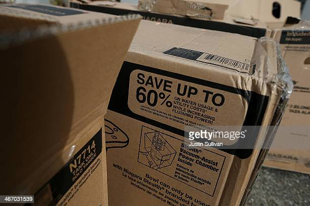 The box of a 08 gallon per flush ultralow flow toilet advertises potential savings at a home on February 5 2014 in Novato California Californians are...