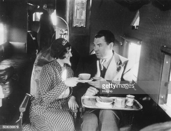 The boxer Jack Dempsey with the first Hostesof the Eastern Transport Lines 23th January 1931 Photograph