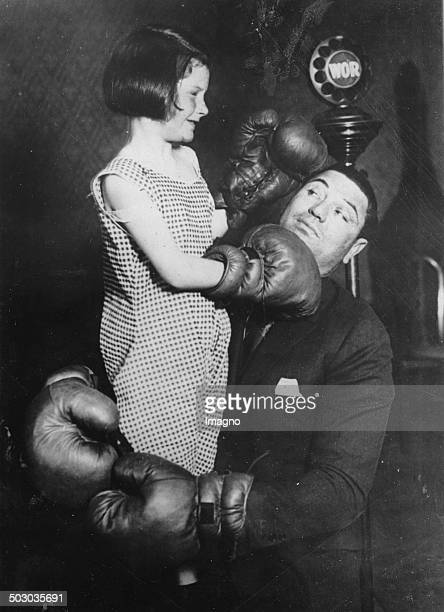 The boxer Jack Dempsey with the little Beverley MacPadden About 1930 Photograph