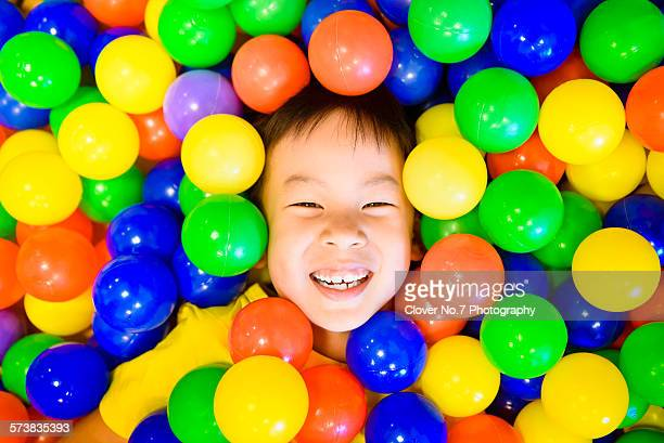 The boy hid the ball pool.