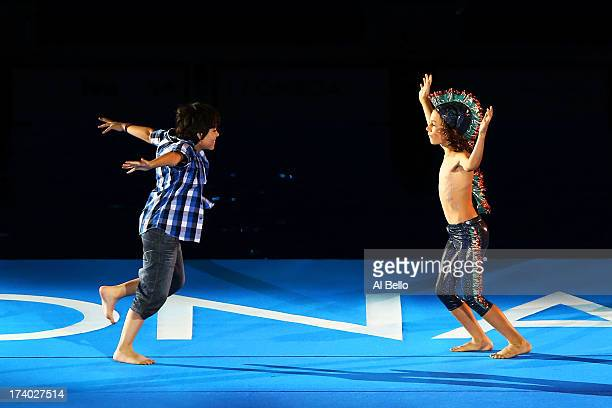 The boy interacts with his friend during the Opening Ceremony of the 15th FINA World Championships at Palau Sant Jordi on July 19 2013 in Barcelona...