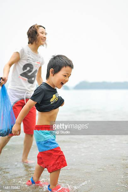 The boy who makes merry on the beach
