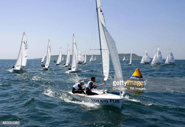 The boy's 420 class boats round the windward mark at the Volvo Youth Sailing ISAF World Championship's at the Weymouth and Portland National Sailing...