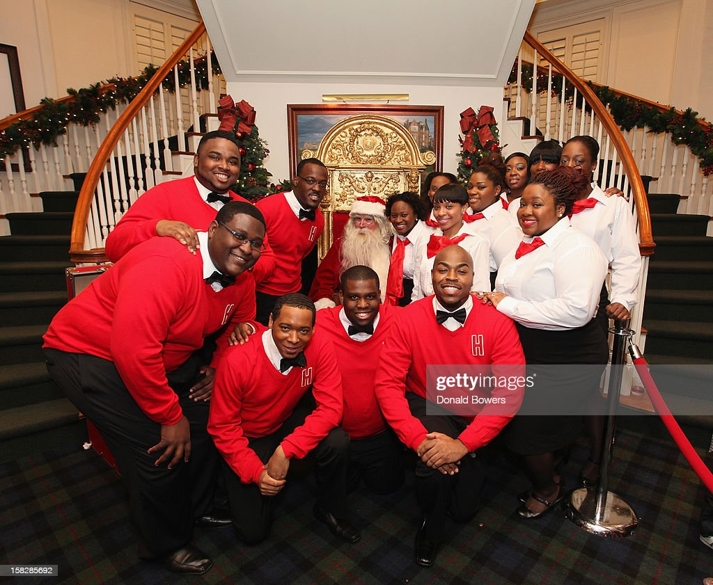 The Boys and Girls Choir of Harlem Alumni Ensemble pose with Santa Claus during The Brooks Brothers Hosts Seventh Annual Holiday Celebration To Benefit St Jude Children's Research Hospital on December 12, 2012 in New York City.