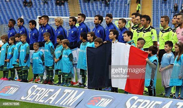 The boys hold the French National flag as teams line up for the French National anthem during the Serie A match between SS Lazio and US Citta di...