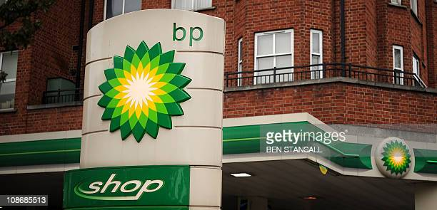 The BP logo is pictured at a petrol station in central London on February 1 2011 BP on Tuesday posted its first annual loss in almost two decades as...