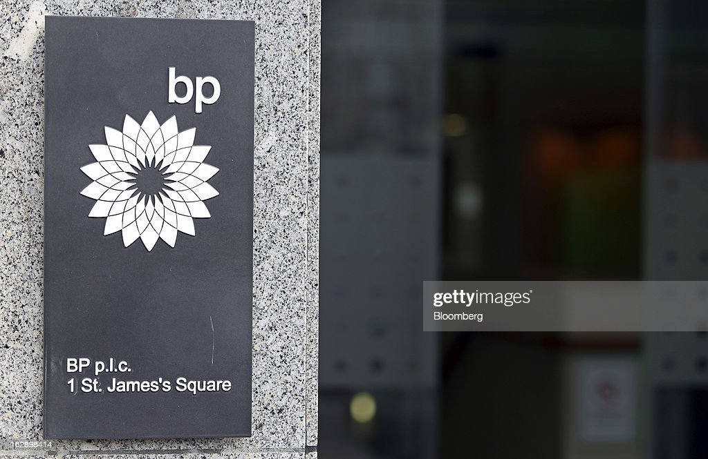 The BP Plc company logo sits on a sign outside the company's headquarters in St. James's Square in London, U.K., on Thursday, Feb. 28, 2013. BP Plc's push to maximize profits and cut costs at the Macondo well was a 'root cause' of the explosion that led to the 2010 Gulf of Mexico oil spill, a safety expert who studied the disaster said. Photographer: Chris Ratcliffe/Bloomberg via Getty Images