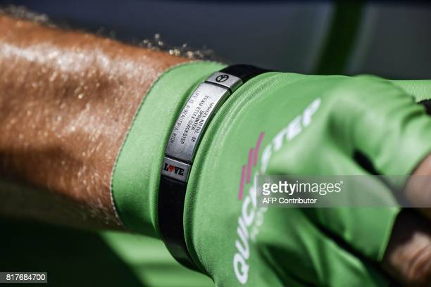 The bracelet of Germany's Marcel Kittel wearing the best sprinter's green jersey is pictured prior to the start of the 165 km sixteenth stage of the...