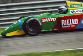 The brakes glow red hot as Alessandro Nannini of Italy drives the Benetton Formula Benetton B190 Ford HB V8 during the San Marino Grand Prix on 13...