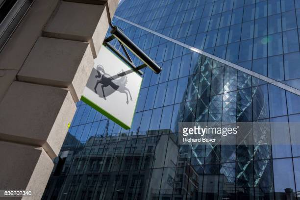The brand of Lloyds Bank a black horse and background banks and insurance headquarters including the Swiss Re building in the capital's oldest...