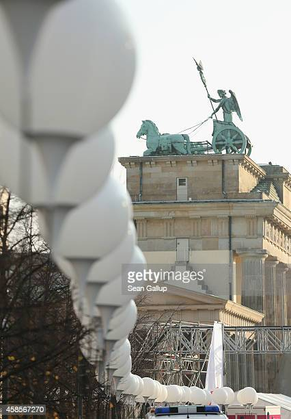 The Brandeburg Gate stands behind lamps tethered to balloons that are part of a light installation to commemorate the 25th anniversary of the fall of...