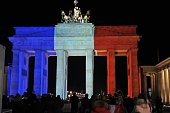 The Brandenburg Gate is illuminated in the French national colors in tribute for the victims of the 13 November Paris attacks in Berlin Germany on...