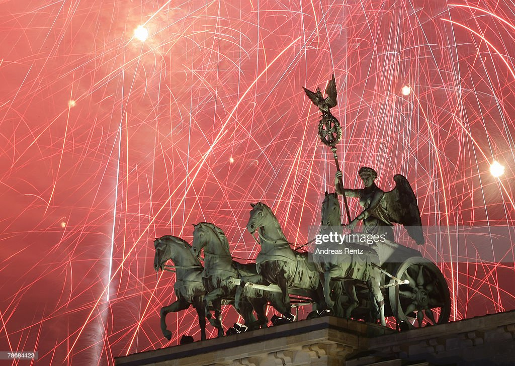 The Brandenburg Gate is lit by fireworks at midnight during the New Year's celebration January 1, 2008 in Berlin, Germany. An estimated 1 million people attended the event.