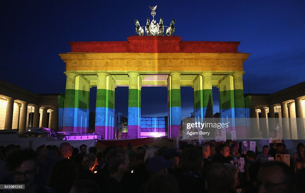 The Brandenburg Gate is seen with a rainbow flag projected onto it during a vigil for victims of a shooting at a gay nightclub in Orlando, Florida nearly a week earlier, in front of the United States embassy on June 18, 2016 in Berlin, Germany. Fifty people were killed and at least as many injured during a Latin music event at the Pulse club in the worst terror attack in the U.S. since 9/11. The American-born gunman had pledged allegiance to ISIS, though officials have yet to find conclusive evidence of his having any direct connection with foreign extremists. The incident has added fuel to the ongoing debate about gun control in the country.