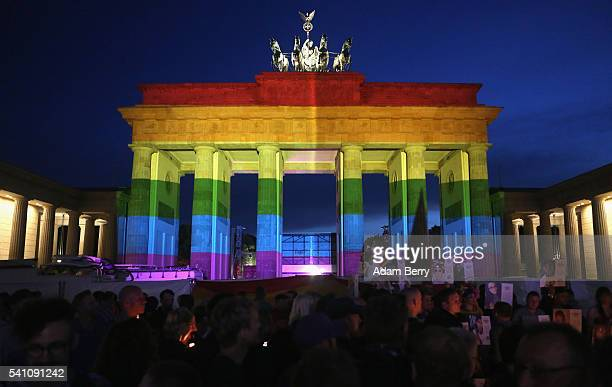 The Brandenburg Gate is seen with a rainbow flag projected onto it during a vigil for victims of a shooting at a gay nightclub in Orlando Florida...