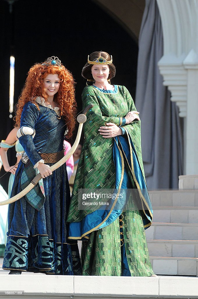 The brave and passionate Disney Princess Merida (L) and Queen Elinor pose during a royal celebration at the Magic Kingdom at Walt Disney World Resort in conjunction with Mother's Day festivities on May 11, 2013 in Lake Buena Vista, Florida.