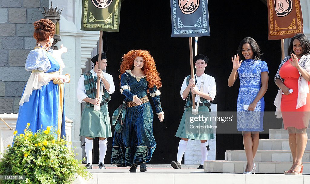 The brave and passionate Merida arrives at her royal celebration as <a gi-track='captionPersonalityLinkClicked' href=/galleries/search?phrase=Gabby+Douglas&family=editorial&specificpeople=8465211 ng-click='$event.stopPropagation()'>Gabby Douglas</a> and her mom Natalie Hawkins join in on the festivities during a royal celebration at the Magic Kingdom at Walt Disney World Resort in conjunction with Mother's Day festivities on May 11, 2013 in Lake Buena Vista, Florida.