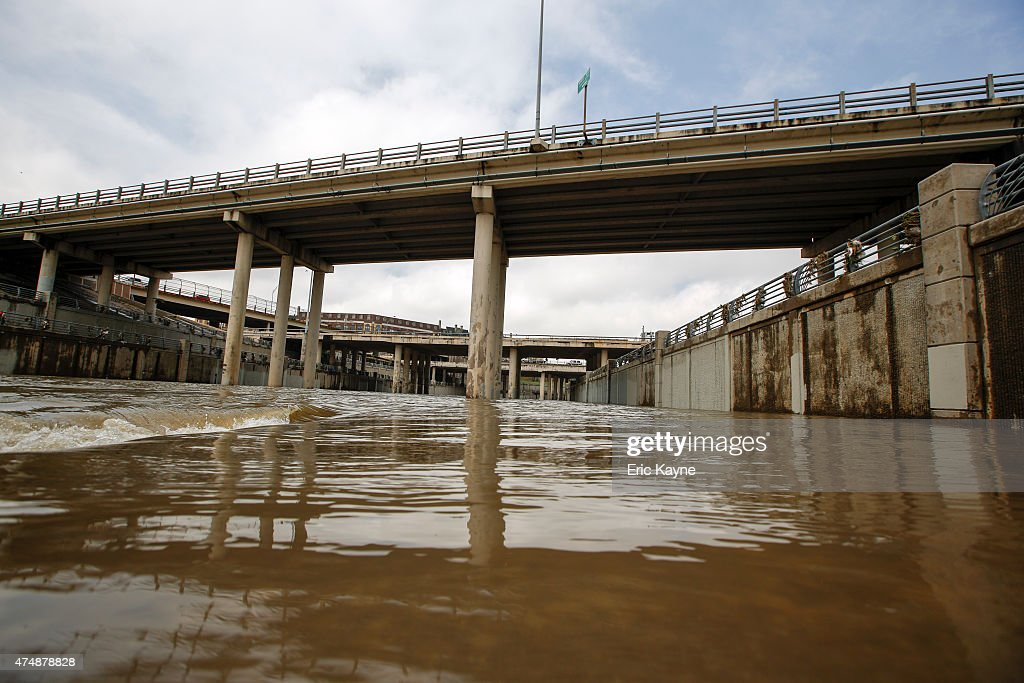 The Brays Bayou flows after massive flooding May 27 2015 in Houston Texas At least 19 people have been killed across Texas and Oklahoma after severe...