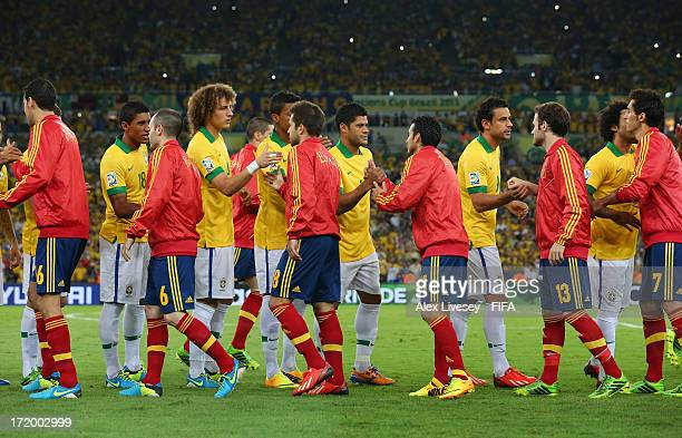 The Brazil and Spain players shake hands prior to the FIFA Confederations Cup Brazil 2013 Final match between Brazil and Spain at Maracana on June 30...
