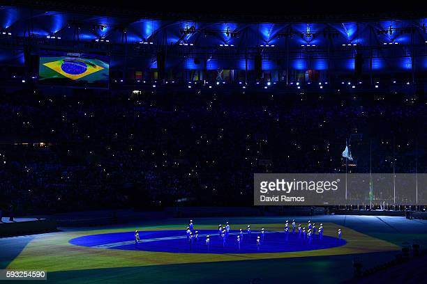 The Brazil national anthem is sung by a children's choir during the Closing Ceremony on Day 16 of the Rio 2016 Olympic Games at Maracana Stadium on...