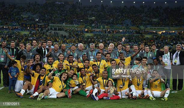 The Brazil players and coaching staff celebrate with the trophy following their victory at the end of the FIFA Confederations Cup Brazil 2013 Final...