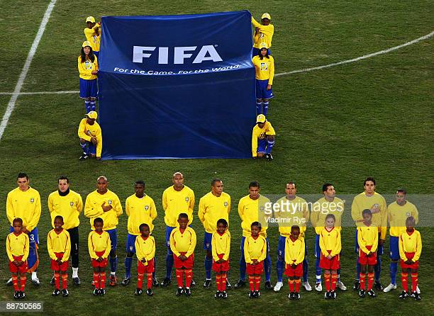 The Brazil players line up for their national anthem prior to the FIFA Confederations Cup Final between USA and Brazil at the Ellis Park Stadium on...