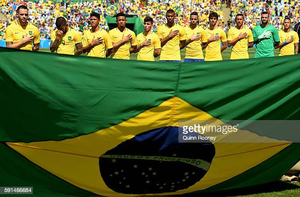 The Brazil team line up ahead of the Men's Semifinal Football match between Brazil and Honduras at Maracana Stadium on Day 12 of the Rio 2016 Olympic...