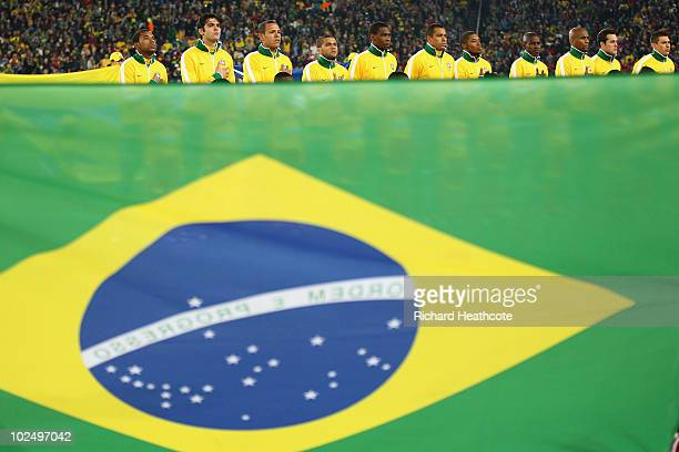 The Brazil team line up for the national anthems prior to the 2010 FIFA World Cup South Africa Round of Sixteen match between Brazil and Chile at...