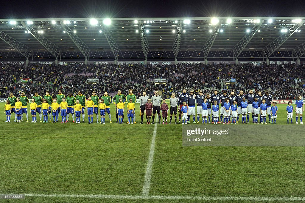 The Brazilian and Italian teams line up prior to the FIFA friendly match between Brazil and Italy on March 21, 2013 in Geneva, Switzerland.