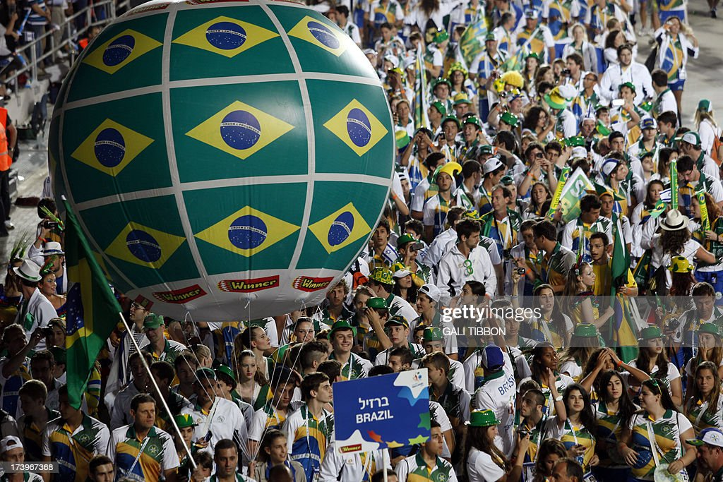 The Brazilian delegation marches during the opening ceremony of The Maccabiah, the Jewish Olympic games, held in Jerusalem under the auspices of the Maccabi Federation on July 18, 2013. AFP PHOTO/GALI TIBBON