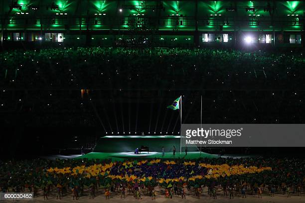 The Brazilian flag is raised as the Brazilian National Anthem is played during the Opening Ceremony of the Rio 2016 Paralympic Games at Maracana...