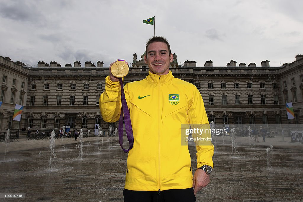 The Brazilian gold medal winner in rings <a gi-track='captionPersonalityLinkClicked' href=/galleries/search?phrase=Arthur+Zanetti&family=editorial&specificpeople=6859190 ng-click='$event.stopPropagation()'>Arthur Zanetti</a> of Brazil poses for a picture during a press conference at Casa Brasil on August 06, 2012 in London, England.