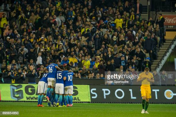 The Brazilian National Football Team celebrate their 2nd goal of the match as James Troisi of the Australian National Soccer Team walks back in...