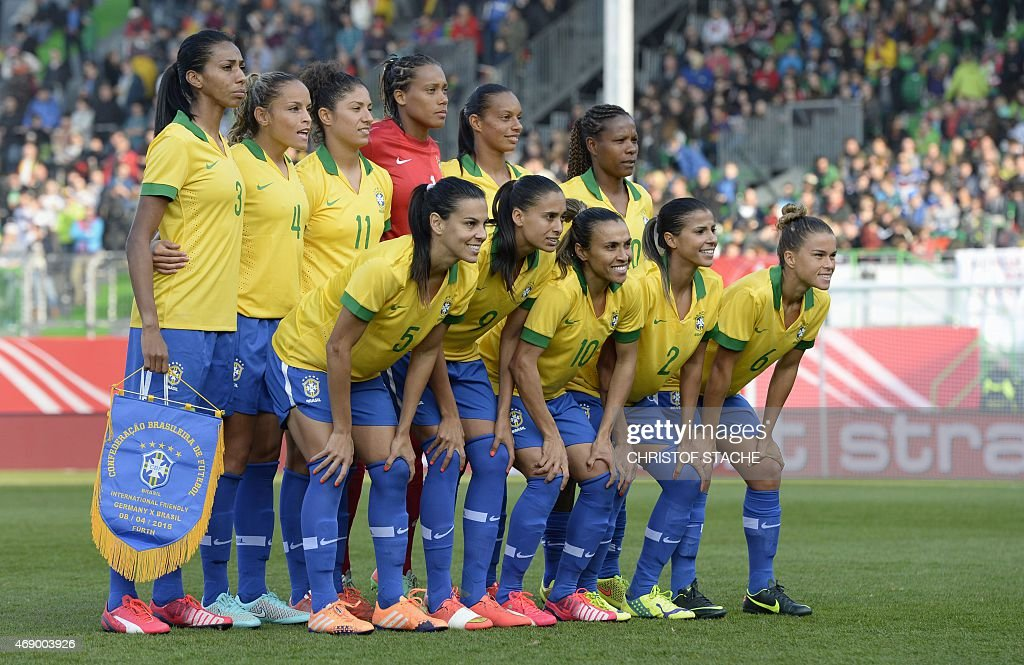 The Brazilian national women football team, first row L-R: Brazilian midfielder Thaisa, Brazilian midfielder Andressa Alves, Brazilian midfielder <a gi-track='captionPersonalityLinkClicked' href=/galleries/search?phrase=Marta+-+Soccer+Player&family=editorial&specificpeople=3038337 ng-click='$event.stopPropagation()'>Marta</a>, Brazilian defender Fabiana and Brazilian defender Tamires, Second row L-R: Brazilian defender Bruna Benites, Brazilian defender Monica, Brazilian striker Cristiane, Brazilian goalkeeper Barbara, Brazilian midfielder Rosana and Brazilian midfielder Formiga, pictured ahead the friendly women soccer match between Germany and Brazil in the stadium in Fuerth, southern Germany, on April 8, 2015.