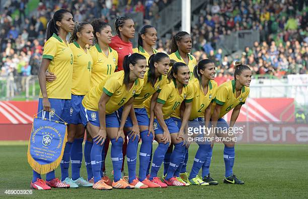 The Brazilian national women football team first row LR Brazilian midfielder Thaisa Brazilian midfielder Andressa Alves Brazilian midfielder Marta...